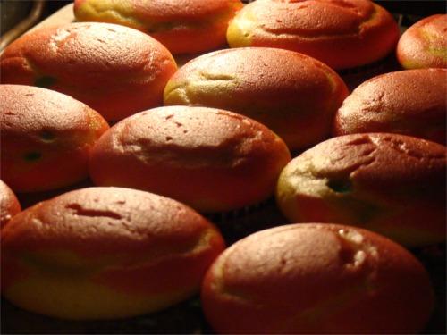 Rainbow cupcakes baking