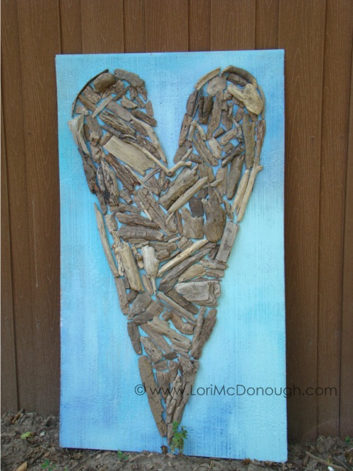 Driftwood art on fence