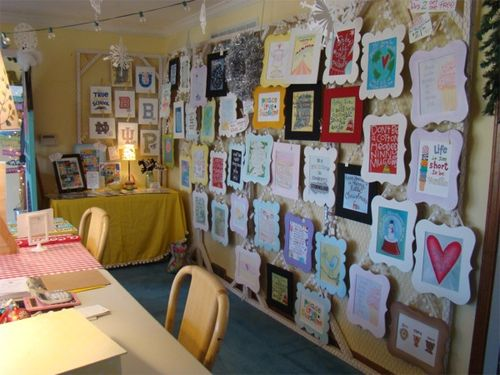 Studio wall of framed prints